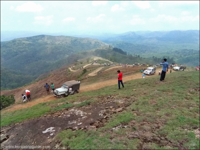 Jeeps take the hairpin bends to reach the top